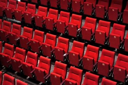 Theatre with empty red seats